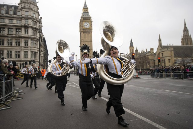 Members of the Appalachian State University Marching Mountaineers band from North Carolina in the U.S., celebrate after taking part in the annual New Year's Day parade in London January 1, 2015. (Photo by Peter Nicholls/Reuters)