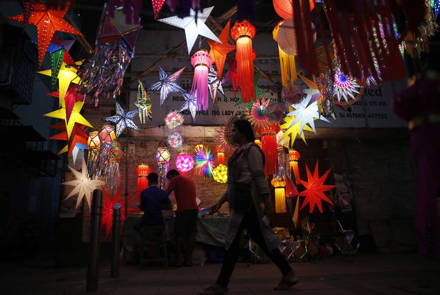 Lanterns are hung on display ahead of Diwali, the Hindu festival of lights, in Mumbai, India, Sunday, October 23, 2016. Diwali is one of Hinduism's most important festivals, dedicated to the worship of the Hindu goddess of wealth Lakshmi. (Photo by Rafiq Maqbool/AP Photo)