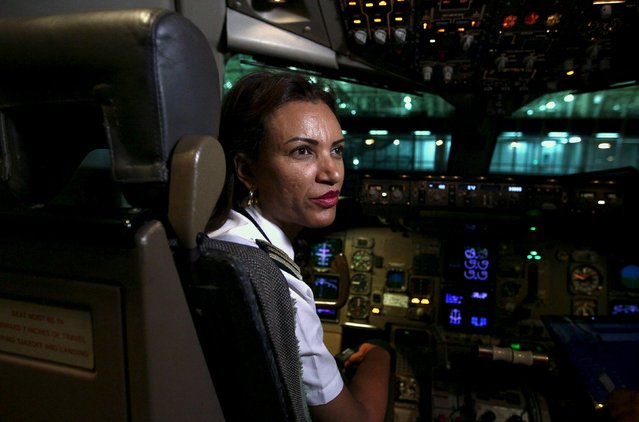 Ethiopian Airlines' first female captain Amsale Gualu prepares for takeoff at Bole international airport in the capital Addis Ababa, November 19, 2015. Ethiopia Airlines on Thursday, dispatched its first ever all-female operated flight. Every aspect of the journey was handled by women, from the ground crew, aircraft maintenance to traffic controllers. Gualu and her co-pilot were charged with flying the crew and passengers to Bangkok, Thailand. (Photo by Tiksa Negeri/Reuters)