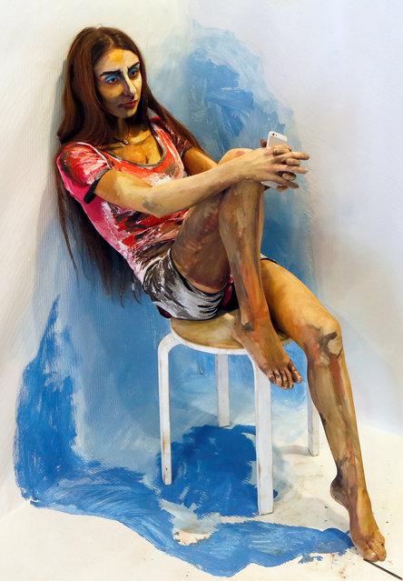 "Model Inna Magomedova presents ""The Alive Painting"" body art work by Russian artist Maria Gasanova during the Art Krasnoyarsk annual festival in Siberian city of Krasnoyarsk, Russia, October 26, 2016. (Photo by Ilya Naymushin/Reuters)"