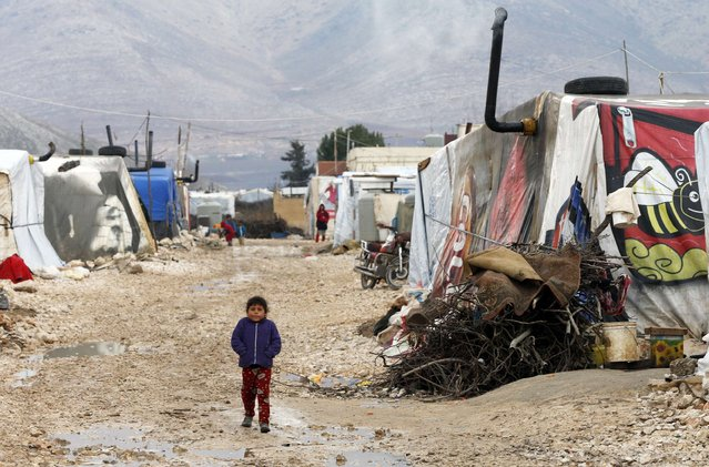 A Syrian refugee girl walks outside tents at a makeshift settlement in Bar Elias in the Bekaa valley January 5, 2015. (Photo by Mohamed Azakir/Reuters)