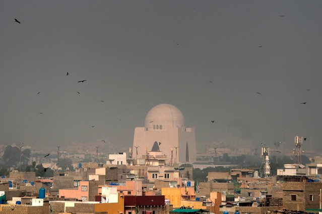 Birds fly around the tomb of the Pakistan's founder Mohammad Ali Jinnah amid heavy smoggy conditions in Karachi on December 8, 2020. (Photo by Asif Hassan/AFP Photo)