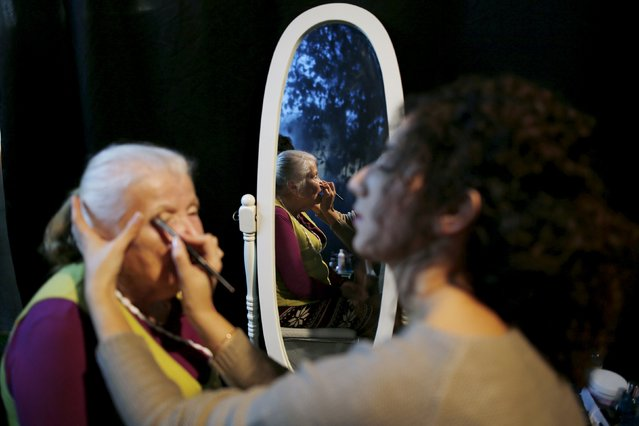 Sarah Israel, 85, (L) a Holocaust survivor, has her make-up done during preparations ahead of a beauty contest for survivors of the Nazi genocide in the northern Israeli city of Haifa, November 24, 2015. (Photo by Amir Cohen/Reuters)