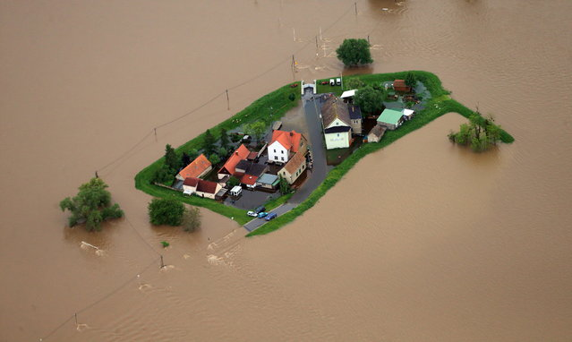 Floodwater of the river Mulde encloses some houses north of Eilenburg, eastern Germany, on June 3, 2013. Parts of the eastern and southern Germany were flooded due to heavy and ongoing rainfalls. (Photo by Jens Wolf/Reuters)