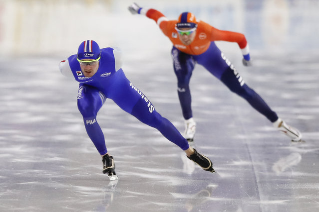 Norway's Sverre Lunde Pedersen, left, and Netherlands' Patrick Roest compete during the men's 1500 meters allround race of the European Speedskating Championships Allround and Sprint at the Thialf ice arena in Heerenveen, northern Netherlands, Sunday, January 17, 2021. (Photo by Peter Dejong/AP Photo)