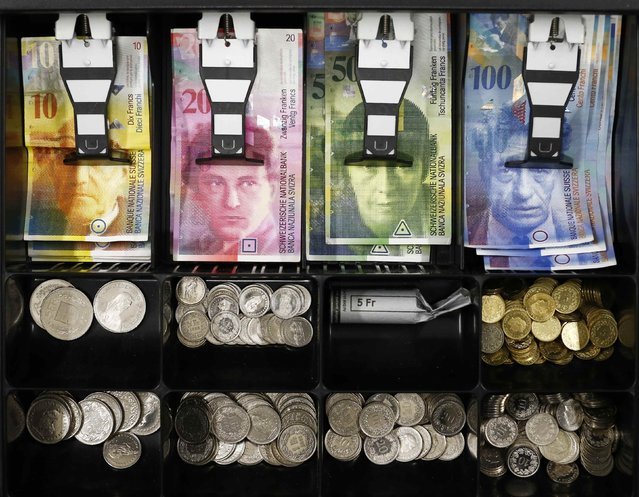 Swiss franc coins are seen in a cash drawer in this picture illustration in Bern January 16, 2015. German bond yields hit record lows on Friday while fears about Greek banks sent the country's borrowing costs spiralling – signs of the fallout from the Swiss National Bank's shock decision to scrap its currency cap. A surge in the Swiss franc after the SNB abandoned its 1.20 euro limit on Thursday saw investors flee equities and other risky assets, parking money instead in top-rated bonds. (Photo by Thomas Hodel/Reuters)