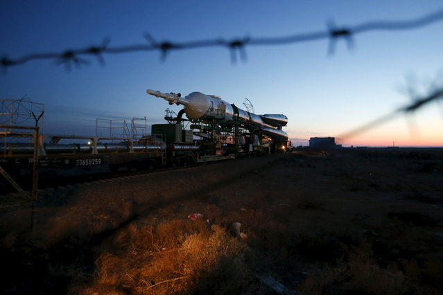 The Soyuz TMA-16M spacecraft is transported to its launch pad at the Baikonur cosmodrome, March 25, 2015. (Photo by Maxim Zmeyev/Reuters)