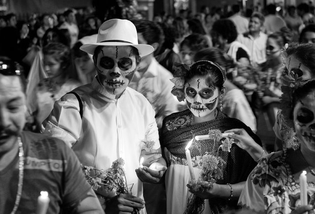 """Día de los Muertos"". It was the first time being in a ""Day of the Dead"" parade. It is interesting to see how Mexicans celebrate death rather than fear it. Location: Mérida, México. (Photo and caption by Patrick Chan/National Geographic Traveler Photo Contest)"