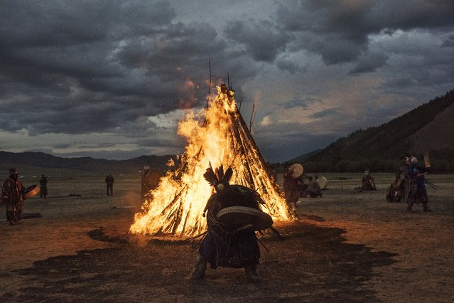 Mongolian Shamans or Buu, take part in a fire ritual meant to summon spirits to mark the period of the Summer Solstice in the grasslands on June 22, 2018 outside Ulaanbaatar, Mongolia. (Photo by Kevin Frayer/Getty Images)