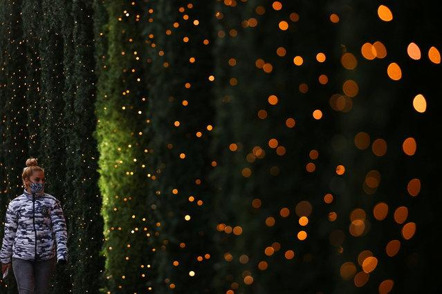 A pedestrian walks near Christmas lights at Oxford Street amid the coronavirus disease (COVID-19) outbreak in London, Britain, November 19, 2020. (Photo by Simon Dawson/Reuters)