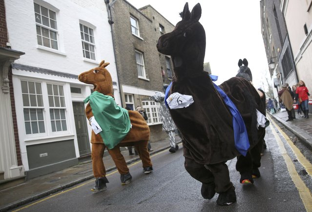 Participants wear costume as they take part in the annual London Pantomime Horse Race in Greenwich, Britain December 13, 2015. (Photo by Neil Hall/Reuters)