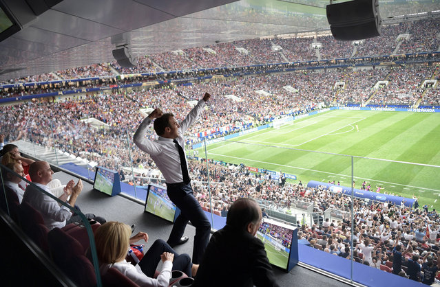 French President Emmanuel Macron (C) reacts as Russian President Vladimir Putin (L) and FIFA President Gianni Infantino (2-L) watch during the FIFA World Cup 2018 final between France and Croatia in Moscow, Russia, 15 July 2018. (Photo by Alexei Nikolsky/EPA/EFE/Sputnik/KRE)