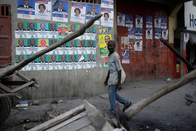 A man walks past electoral posters before the election in a street of Les Cayes, Haiti, November 19, 2016. (Photo by Andres Martinez Casares/Reuters)