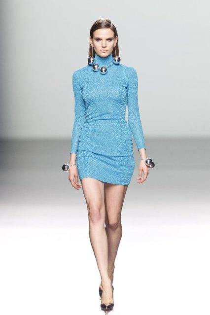 A model displays an Autumn/Winter design by Maria Escote at Madrid's Fashion Week in Madrid, Spain, Tuesday, February 10, 2015. (Photo by Daniel Ochoa de Olza/AP Photo)