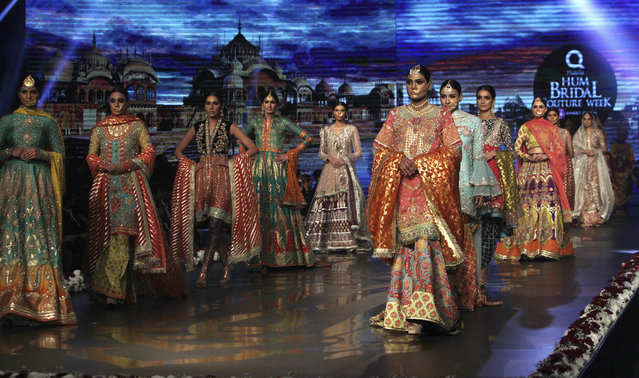 Models present bridal creations by designer Wardha Saleem during Bridal Couture Week 2016 in Lahore, Pakistan, Sunday, November 27, 2016. (Photo by K.M. Chaudary/AP Photo)