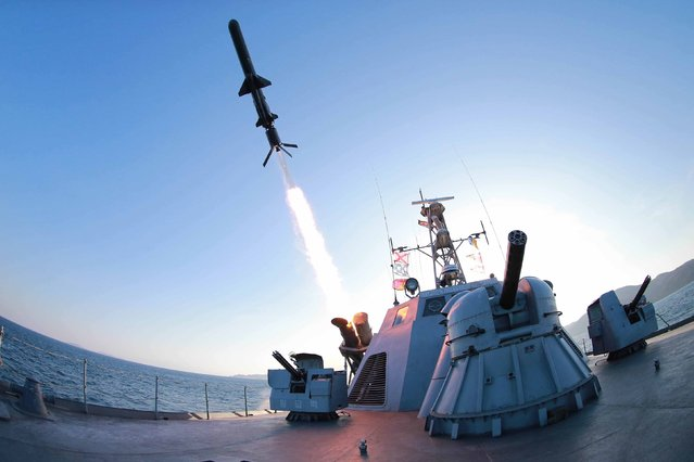 A missile is fired from a naval vessel during the test-firing of a new type of anti-ship cruise missile to be equipped at Korean People's Army (KPA) naval units in this undated photo released by North Korea's Korean Central News Agency (KCNA) in Pyongyang February 7, 2015. (Photo by Reuters/KCNA)