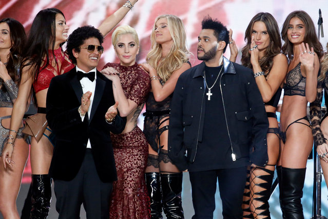 Musicians Bruno Mars (3rdL), Lady Gaga (4thL) and The Weeknd (3rdR) appear with models at the end of the 2016 Victoria's Secret Fashion Show at the Grand Palais in Paris, France, November 30, 2016. (Photo by Charles Platiau/Reuters)