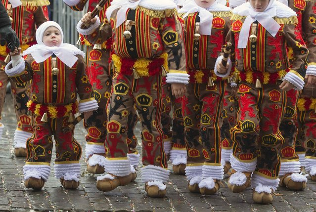 Hugo Belleri (L), a three-year-old boy and the youngest Gilles of Binche, takes part in the parade of Young Gilles of Binche during the carnival event in Binche February 17, 2015. (Photo by Yves Herman/Reuters)