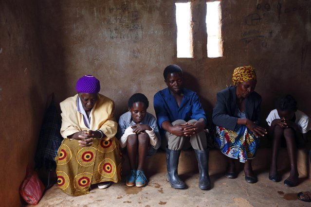 HIV-positive members of a self-help group pray at the start of a meeting in the village of Michelo, south of the Chikuni Mission in the south of Zambia February 23, 2015. (Photo by Darrin Zammit Lupi/Reuters)