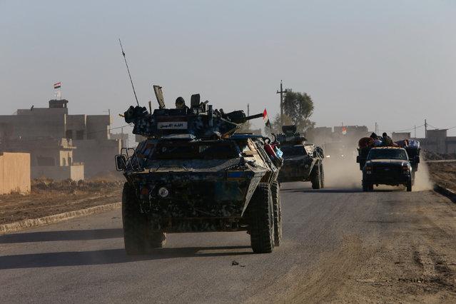 Iraqi security forces members drive a military vehicle in Qaraqosh, near Mosul, Iraq December 9, 2016. (Photo by Alaa Al-Marjani/Reuters)