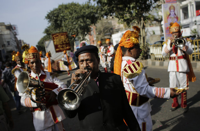 Members of a brass band play religious tunes during in a religious procession on Ram Navami festival in New Delhi, India, Saturday, March 28, 2015. (Photo by Altaf Qadri/AP Photo)