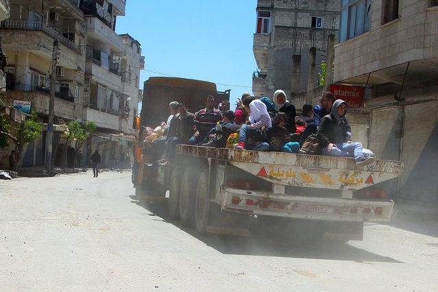 Residents flee Jisr al-Shughour town after rebels took control of the area April 25, 2015. (Photo by Ammar Abdullah/Reuters)