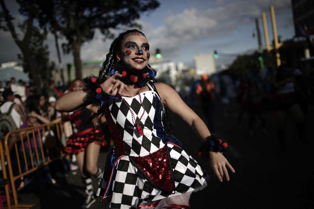 "A person participates in the parade of the ""San Jose Carnival"" in San Jose, Costa Rica, 27 December 2018. The festival sees people parading through the city's main avenues as part of the San Jose Celebrations that take place at the end of each year. (Photo by Jeffrey Arguedas/EPA/EFE)"