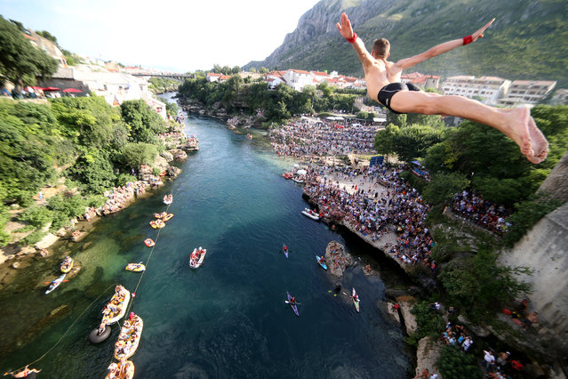 A man jumps from the Old Bridge during the 452nd traditional diving competition in Mostar, Bosnia and Herzegovina on July 29, 2018. (Photo by Dado Ruvic/Reuters)