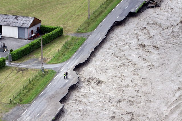 Aerial picture taken on June 19, 2013 in Villelongue shows the flooded Gave de Pau river one day after unseasonal storms caused havoc across huge swaths of the country. (Photo by Laurent Dard/AFP Photo)