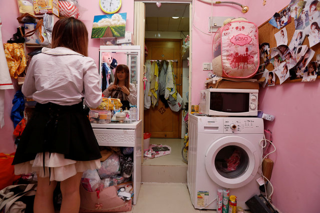 Manman Luk, a freelance model and make up artist, poses inside her 100-square-foot (9-square-metre) sub-divided unit, paying a monthly rent of HK4,700 ($606) in Hong Kong, China January 6, 2017. (Photo by Bobby Yip/Reuters)