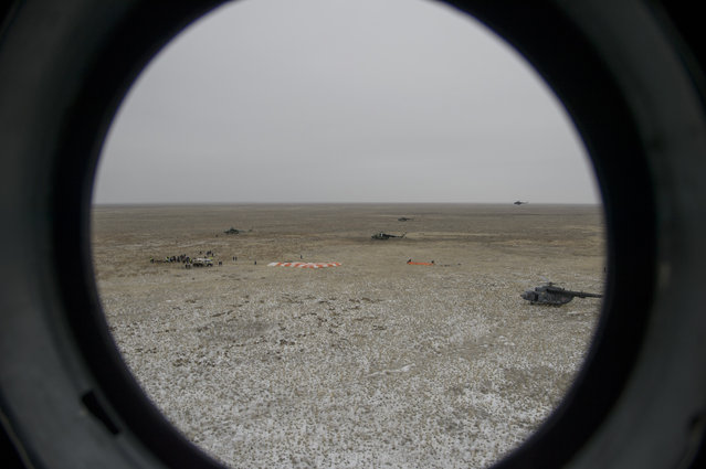 In this handout provided by NASA, The Soyuz TMA-18M spacecraft landing site is seen through the window of an arriving Russian MI-8 helicopter after Expedition 46 Commander Scott Kelly of NASA and Russian cosmonauts Mikhail Kornienko and Sergey Volkov of Roscosmos landed in their capsule on March 2, 2016 near the town of Zhezkazgan, Kazakhstan. (Photo by Bill Ingalls/NASA via Getty Images)