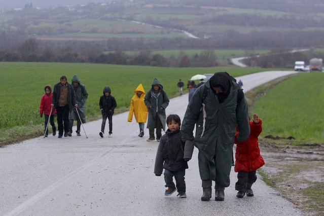 Migrants walk along a road from the village of Chamilo to the migrant camp at the village of Idomeni, near the Greek-Macedonian border, Greece March 15, 2016. (Photo by Ognen Teofilovski/Reuters)