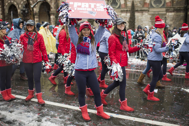 New England Patriots cheerleaders walk down Boylston Street during the Patriots victory parade on February 7, 2017 in Boston, Massachusetts. The Patriots defeated the Atlanta Falcons 34-28 in overtime in Super Bowl 51. (Photo by Michael J. Ivins/Getty Images)