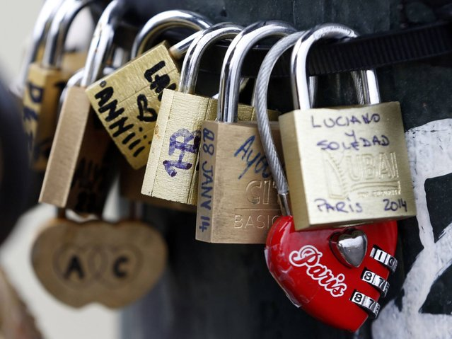 For couples visiting Paris these locks are symbols of their everlasting love. In other cities the locks have also caught on as an expression of passion – in Seoul, Budapest, Rome and Tokyo. (Photo by Charles Platiau/Reuters)