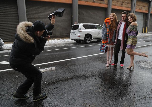 A fashion photographer photographs guests arriving for a fashion show at Skylight Clarkson Square during Fashion Week, Thursday, February 9, 2017, in New York. (Photo by Julie Jacobson/AP Photo)