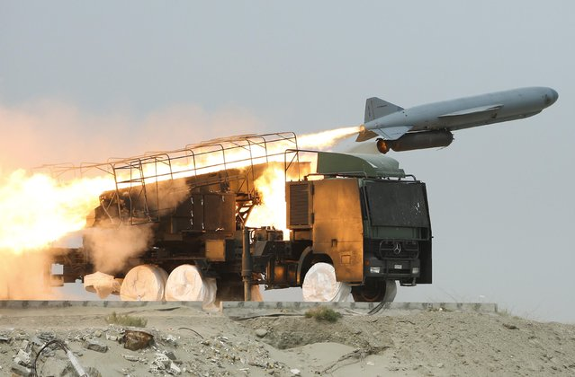 A Saegheh missile is fired from its launch vehicle during Iran's Revolutionary guards war games in the Hormuz area of southern Iran, April 2010. (Photo by Mehdi Marizad/Fars News via Reuters)