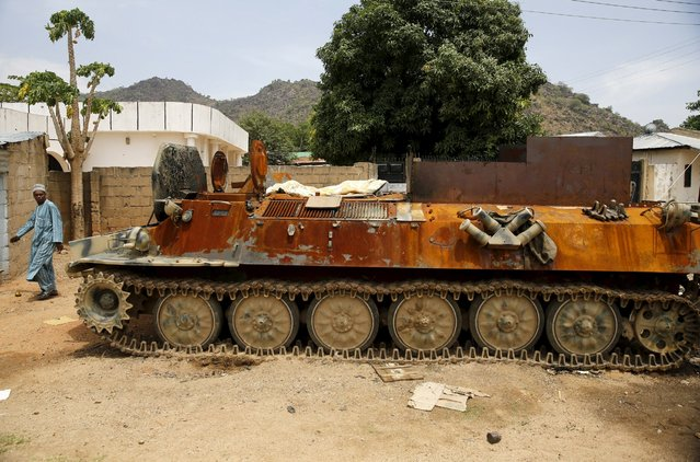 A burnt armour tank is seen abandoned along a road in Bazza town after the Nigerian military recaptured it from Boko Haram, in Adamawa state May 10, 2015. (Photo by Akintunde Akinleye/Reuters)