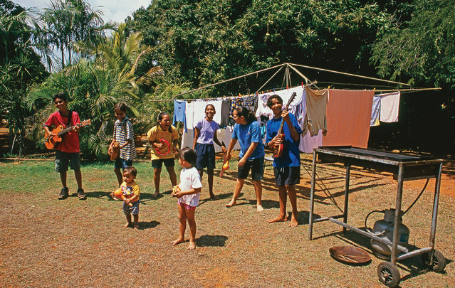 """The Little Piggies"", aka the children of folk rockers the Pigram Brothers, sing around a clothesline in Broome in the Kimberley. (Photo by Frances Andrijich)"