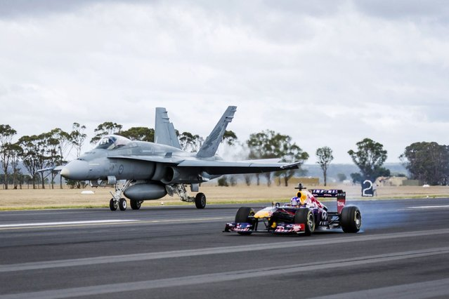 Daniel Ricciardo performs alongside Michael Kneightley in an RAAF F/A-18 Hornet at RAAF Base in East Sale, Victoria, Australia on March 12th, 2014. (Photo by Andy Green/Red Bull Content Pool)