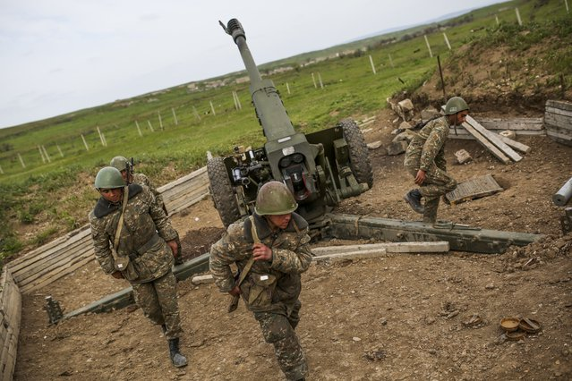 Nagorno-Karabakh army artillerymen prepare to open fire from a howitzer on positions in Nagorno-Karabakh, Azerbaijan, Tuesday, April 5, 2016. (Photo by Vahan Stepanyan/PAN Photo via AP Photo)