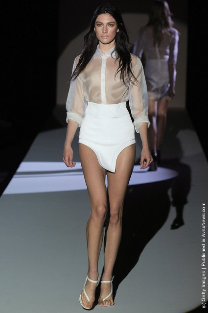 A model walks the runway at the Hakaan Spring Summer 2012 fashion show during Paris Fashion Week