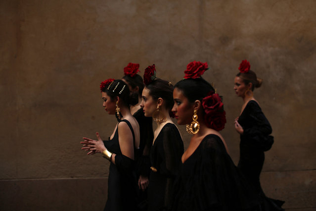 Models wearing flamenca dresses head to an event to mark the twentieth anniversary of the International Flamenco Fashion Show in Seville, Spain, on March 27, 2014. (Photo by Marcelo del Pozo/Reuters)