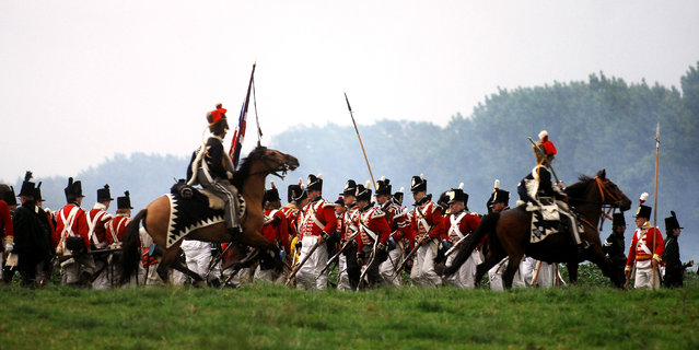 In this June 16, 2007, file photo, actors dressed as soldiers re-enact the Battle of Waterloo in Braine-l'Alleud, near Waterloo, Belgium. The Battle of Waterloo, fought on June 18, 1815, was Napoleon Bonaparte's last battle, as his defeat put a final end to his rule as Emperor of France. (AP Photo/Geert Vanden Wijngaert, File)