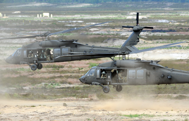 U.S. Army helicopters transport soldiers during the NATO Noble Jump exercise on a training range near Swietoszow Zagan, Poland, Thursday, June 18, 2015. (AP Photo/Alik Keplicz)