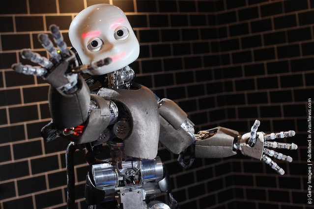 An iCub robot built by the Italian Institute of Technology tracks a ball in the Robotville exhibition at the Science Museum on November 29, 2011 in London, England