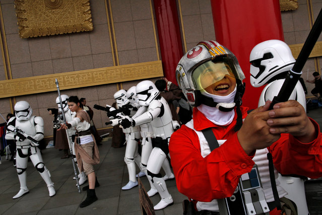 A man dressed as the character Poe Damaron (R) from Star Wars takes a selfie during Star Wars Day in Taipei, Taiwan, May 4, 2016. (Photo by Tyrone Siu/Reuters)