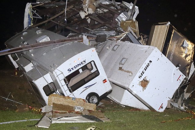 Travel trailers and motor homes are piled on top of each other at Mayflower RV in Mayflower, Ark., Sunday, April 27, 2014.A powerful storm system rumbled through the central and southern United States on Sunday, spawning tornadoes. (Photo by Danny Johnston/AP Photo)