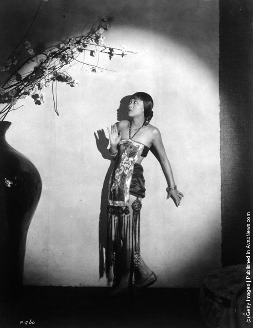 circa 1930:  Chinese-American actress Anna May Wong (1907 - 1961) surrounded by ominous shadows