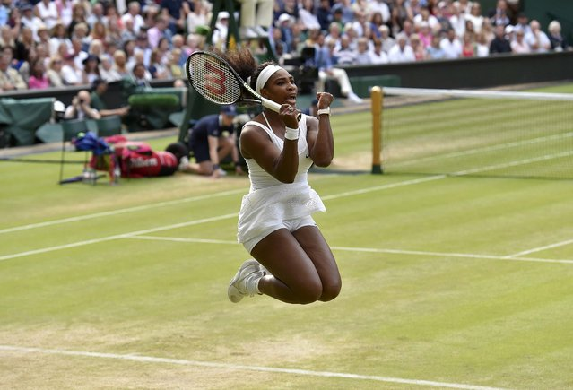 Serena Williams of the U.S.A. celebrates after winning her match against Victoria Azarenka of Belarus at the Wimbledon Tennis Championships in London, July 7, 2015. (Photo by Toby Melville/Reuters)