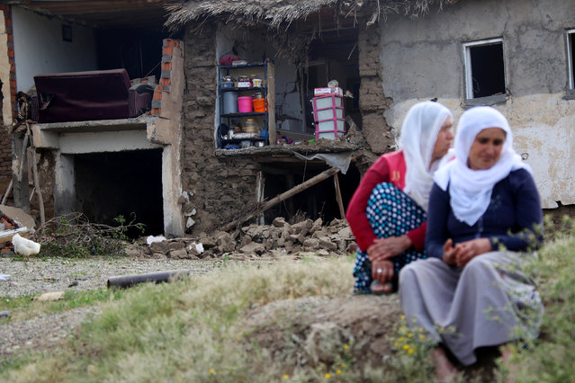 Women sit in front of a house which was damaged in the last night's explosion, near the Kurdish-dominated southeastern city of Diyarbakir, Turkey May 13, 2016. (Photo by Sertac Kayar/Reuters)